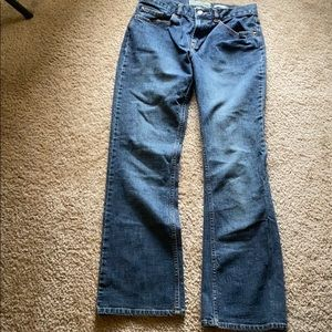 Low rise boot cut jeans.